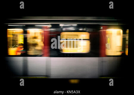 Moving train at night - subway line - Stock Photo
