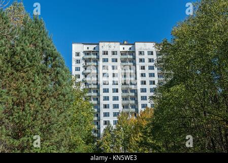 16-storied apartment house in Pripyat town, Chernobyl Nuclear Power Plant Zone of Alienation, Ukraine. - Stock Photo