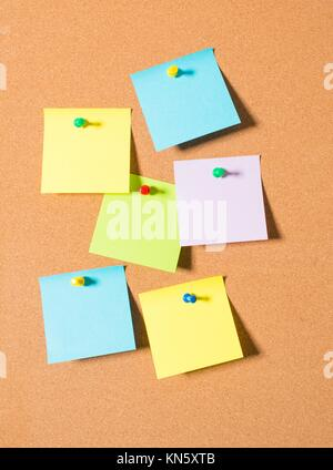 Post it notes on cork message board. - Stock Photo