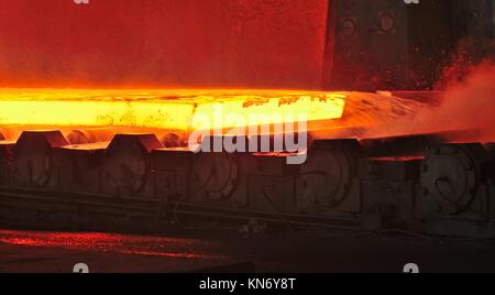 hot plate on conveyor inside of steel plant. - Stock Photo
