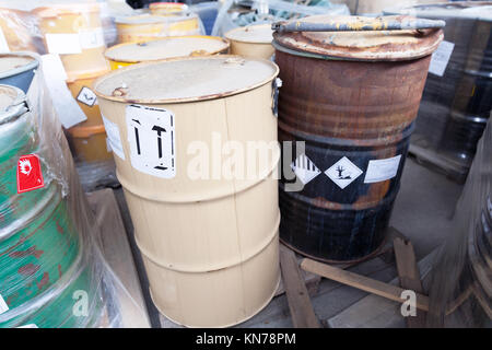 Rusty barrels with toxic chemical waste - Stock Photo