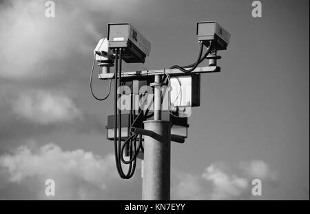 A pair of CCTV cameras on a gantry at Ashford in Kent, England on February 7, 2008. - Stock Photo