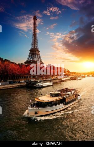 Eiffel tower on the bank of Seine in Paris, France. - Stock Photo