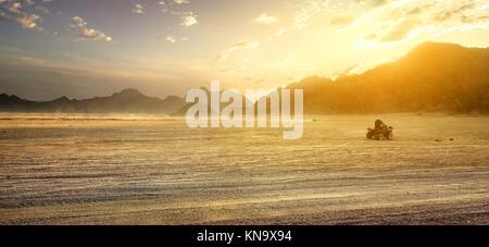 Sandy field in desert of Egypt at sunset. - Stock Photo