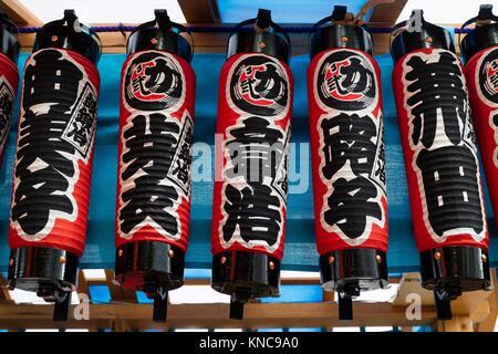 Tokyo, Japan - May 14, 2017: Row of paper lanterns with Japanese characters along the street at the Kanda Matsuri - Stock Photo