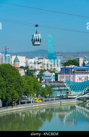 Aerial tramway and the Bridge of Peace, Kura River, Tbilisi City, Georgia, Middle East. - Stock Photo