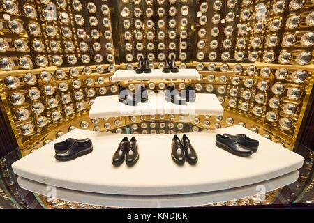 Luxury shoes at Prada shop inside Galleria Vittorio Emanuele II. Milano. Lombardy. Italy. - Stock Photo