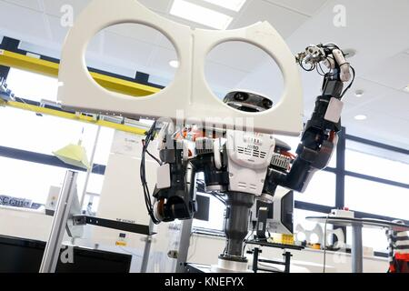 Robot with two arms for flexible robotics. Humanoid robot for automotive assembly tasks in collaboration with people, - Stock Photo