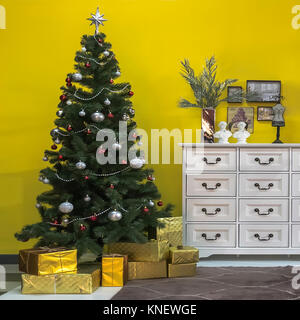 Beautiful Christmas tree with gift boxes in interior of living room - Stock Photo
