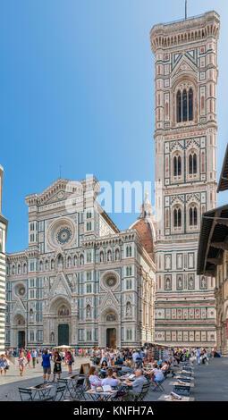 Campanile and Duomo, Florence. Cafe in front of the Cattedrale di Santa Maria del Fiore (Il Duomo) and the Campanile, - Stock Photo