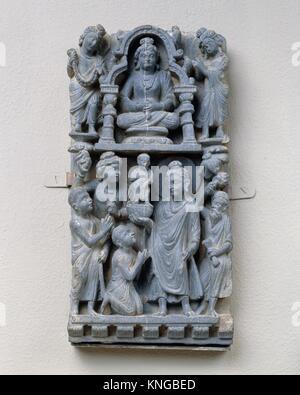 Relief Panel: Presentation of a Statue. Date: 3rd-5th century; Culture: Pakistan (ancient region of Gandhara); Medium: - Stock Photo