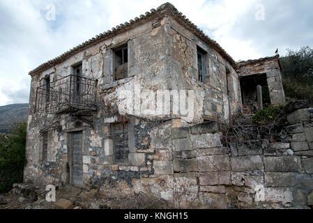 Derelict house in the hills near Kardamyli, Greece - Stock Photo