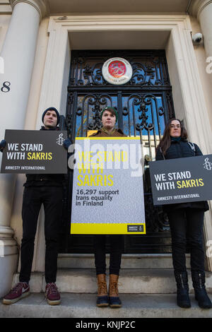 London, UK. 12th December, 2017. Amnesty International activists protest outside the Finnish embassy to call for - Stock Photo