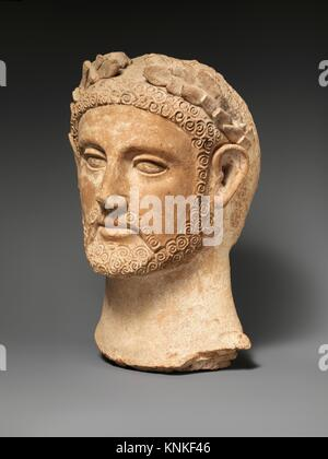 Terracotta head of a man wearing a wreath. Period: Cypro-Classical II; Date: ca. 400-310 B.C; Culture: Cypriot; - Stock Photo