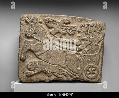 Orthostat relief: lion-hunt scene. Period: Neo-Hittite; Date: ca. 9th century B.C; Geography: Syria, Tell Halaf - Stock Photo