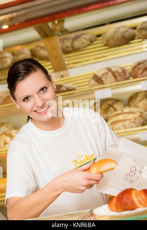 Angestellte in der Baeckerei - clerk in a bakery - Stock Photo