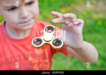 Hand Spinner, also known as fidget spinner, a finger toy that enhances concentration. It's said to have therapeutic - Stock Photo