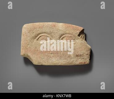 Limestone plaque with two eyes. Period: Classical; Date: 480-310 B.C; Culture: Cypriot; Medium: Limestone; Dimensions: - Stock Photo