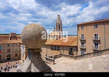 Sant Feliu or San Felix church tower stands out as seen from the steps leading to Santa Maria de Girona Cathedral. - Stock Photo