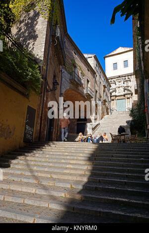 Stairs leading to Sant Marti Sacosta church -Pujada de Sant Domenec. On the left the arch of the Casa Palau de Agullana. - Stock Photo