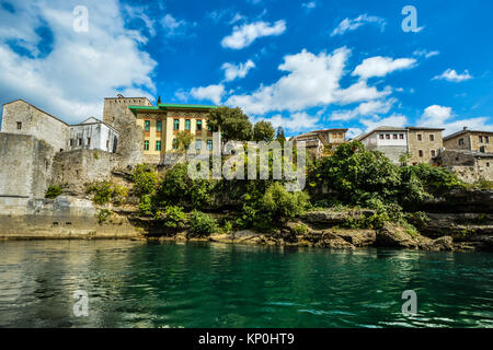 Colorful home on the shore of the Neretva River by the old bridge in Mostar Bosnia and Herzegovina - Stock Photo