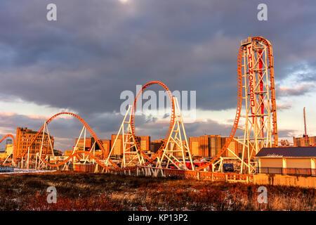Brooklyn, New York - Dec 10, 2017: Thunderbolt Rollercoaster in Coney Island, Brooklyn, New York City at sunset. - Stock Photo
