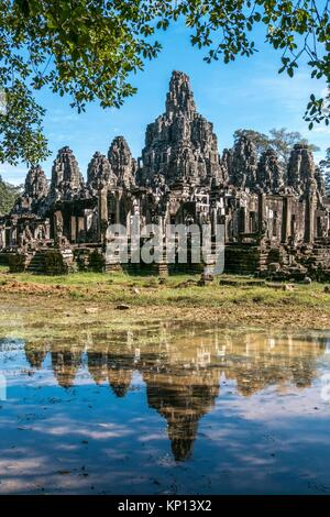 The Bayon at Angkor Thom, the largest Khmer city ever built was the state temple of Jayavarman VII and is a part - Stock Photo