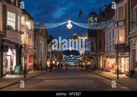 The High Street in Guildford with Christmas Lights and the famous Guildhall gold clock in blue hour on a late night - Stock Photo