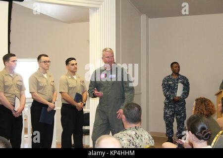 PENSACOLA, Fla. (Dec. 1, 2017)-Naval Air Station (NAS) Pensacola Commanding Officer, Capt. Christopher Martin, addresses - Stock Photo