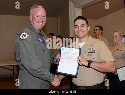 PENSACOLA, Fla. (Dec. 1, 2017)- Naval Air Station (NAS) Pensacola Commanding Officer, Capt. Christopher Martin, - Stock Photo