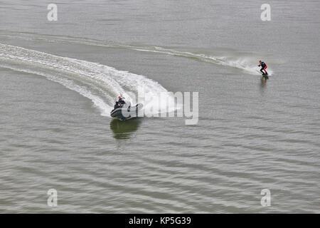 Water skiing on a finnish baltic sea coastline. Aquatic sport - Stock Photo