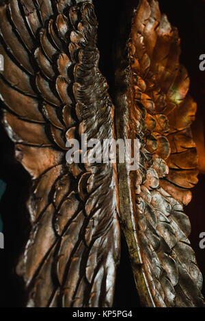 Decorated metal wings isolated on black background - Stock Photo