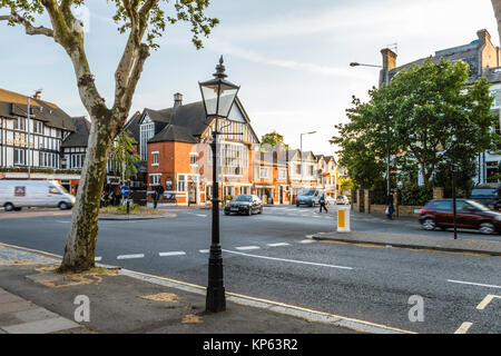 Junction of Hampstead Lane and North Hill, Highgate, London, UK. Gatehouse Pub and Theatre on left, a traditional - Stock Photo