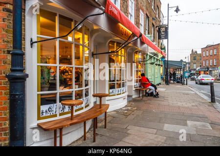 The high street in Highgate Village, London, UK, on a December evening - Stock Photo