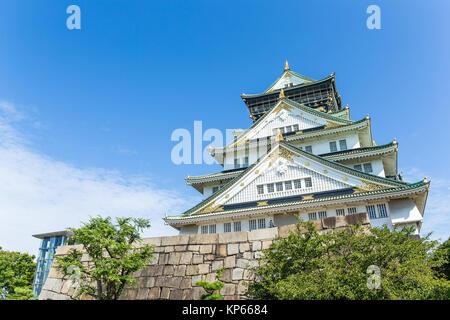 Osaka Castle with clear blue sky - Stock Photo