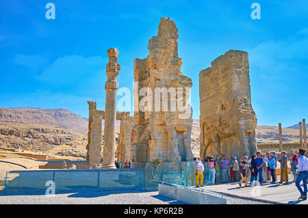 PERSEPOLIS, IRAN - OCTOBER 13, 2017: The numerous tourists next to the All Nations Gate (Xerxes Gate) in Persepolis - Stock Photo