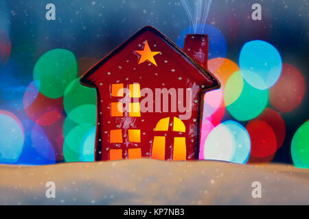 Closeup photo of a red little decorative house, cute bauble for Christmas tree, stylish festive still life, traditional - Stock Photo