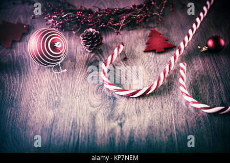 Vintage Christmas background, beautiful Christmastime decorations on wooden background, traditional red and white - Stock Photo