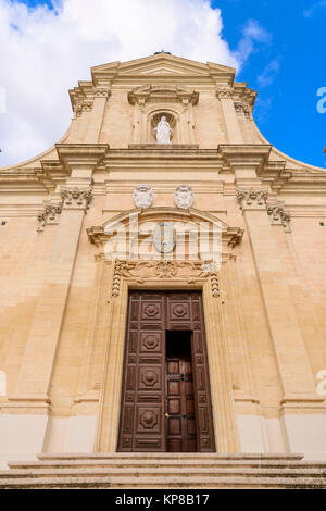 Wooden door entrance to the Citadella Citadel Cathedral, Victoria, Gozo, Malta. - Stock Photo