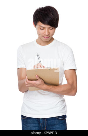 Young university student write on clipboard - Stock Photo