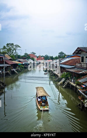 Boat and traditional canal village in Thailand - Stock Photo