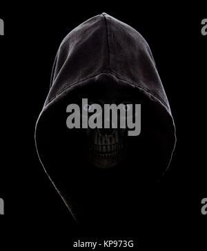 Hooded scull in the dark. Fear. - Stock Photo