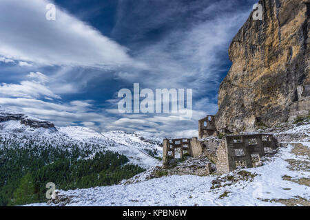 Dolomite mountain landscape after a fresh snowfall in late autumn with ruins of a World War One fortress - Stock Photo