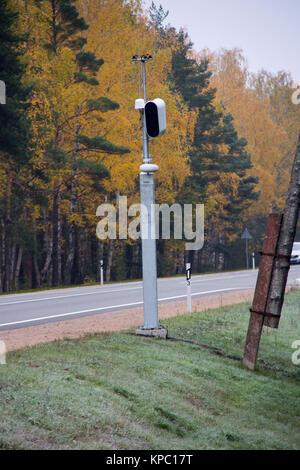 Traffic enforcement camera speed control radar camera at countryside road highway Latvia - Stock Photo