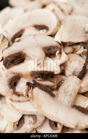 Freshly cut white button mushrooms for cooking - Stock Photo