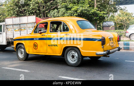 Iconic yellow indian taxi in Calcutta.  The Ambassador tax vehicle is no longer being built. - Stock Photo