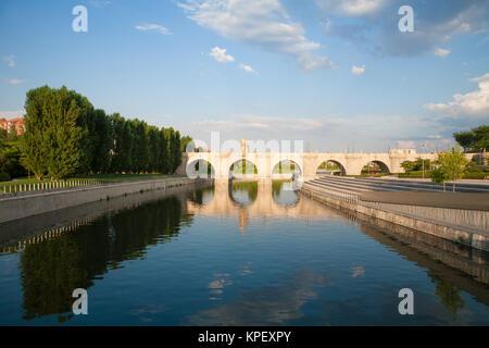 ancient bridge in Madrid river - Stock Photo