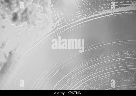 soap foam stains on the glass - Stock Photo