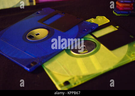 Closeup of blue and yellow green floppy disk - Stock Photo