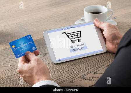 Close-up Of Businessman Shopping Online - Stock Photo